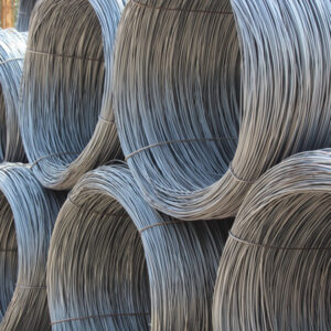 Plain Wire rolls stacked together outside steel supplies
