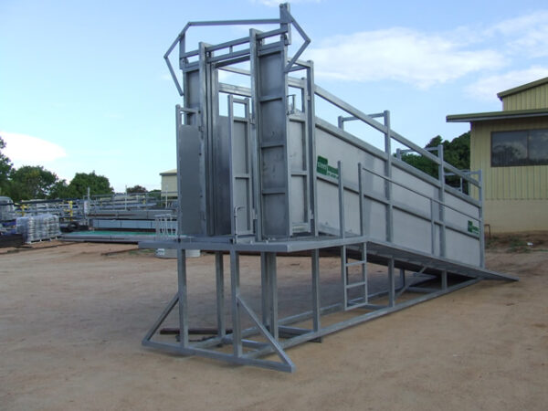 Cattle ramp with steel supplies charters towers branding in a yard