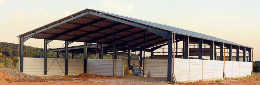 Large shed with open walls on gravel