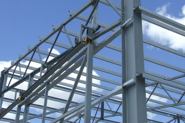 steel shed being constructed with exposed beams